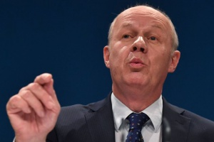 British Work and Pensions Secretary Damian Green delivers a keynote address on the third day of the annual Conservative Party conference at the International Convention Centre in Birmingham, central England, on October 4, 2016. British Prime Minister Theresa May announced at the weekend that her Conservative government would start the process of leaving the EU within the next six months -- possibly leading to Britain severing ties with the single market. / AFP / BEN STANSALL (Photo credit should read BEN STANSALL/AFP/Getty Images)